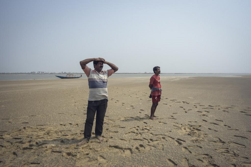 Mayadhar (left), a local fishermen, says that the increased salinity has affected the number of fishes in the lake, in turn having an adverse impact on their catch. Photo: Adithyan P C