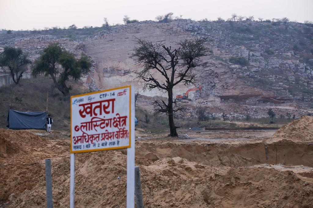Illegal stone quarries in Sonha town of Haryana have caused permanent damage to the Aravallis. Of the state's 22 districts, Aravallis are present in Mewat, Faridabad, Gurugram, Mahendragarh and Rewari, all of which are currently, or were till recently, heavily mined and have undergone rapid developmental and construction activities. Photo: Vikas Choudhary; Text: Pranay Lal