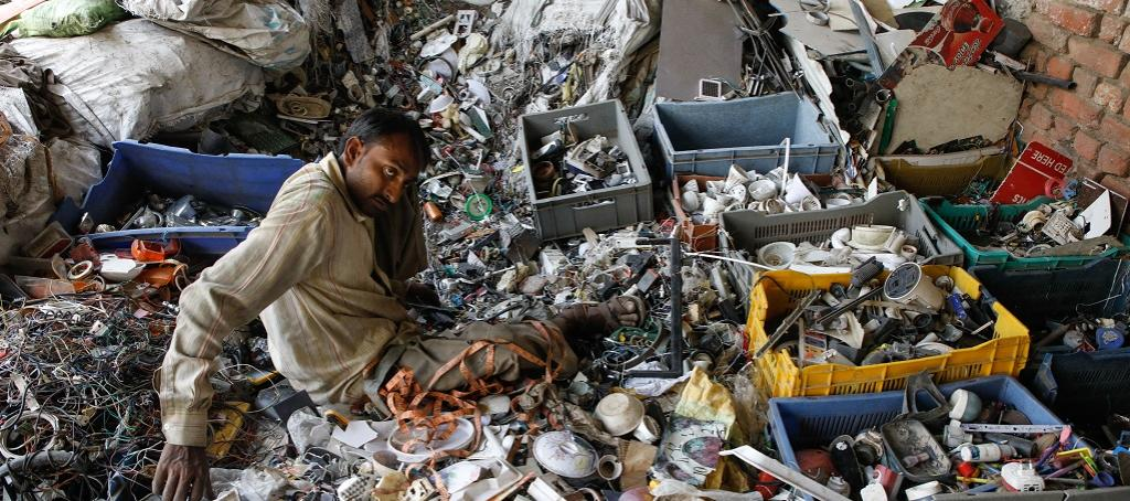 Labourers sort through plastic waste at the Tikri Kalan plastic waste depot in New Delhi. Photo: Vikas Choudhary