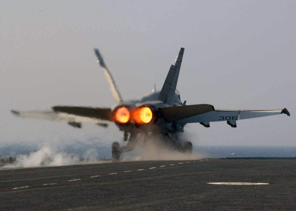 A U.S. Navy F/A-18 Hornet launching from the USS Theodore Roosevelt on full afterburner. Photo: The Conversation