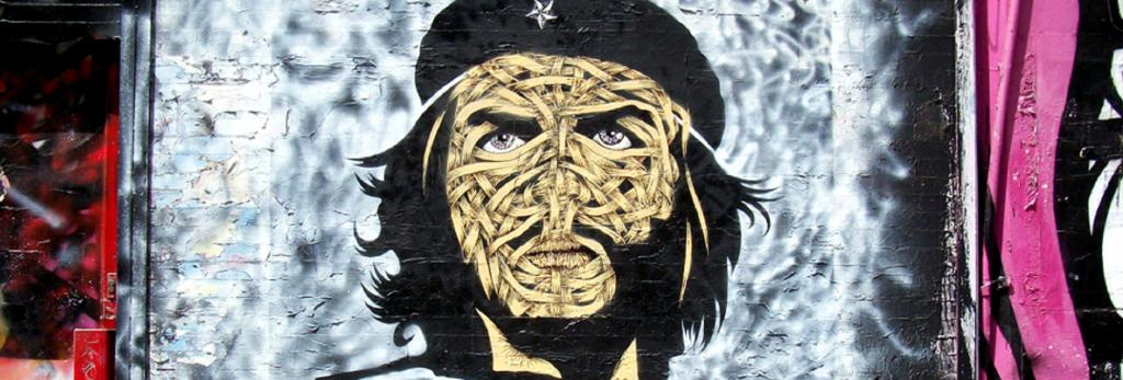 The ribbons on this grafitti portrait by London-based Chilean artist Otto Schade play with idea of presence and absence. The eyes evoke the intensity of the original. Artist: Otto Schade