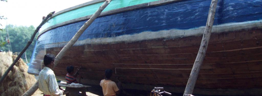 Carpenters repairing a fishing vessel in Kharinashi village. Photo: Ashis Senapati