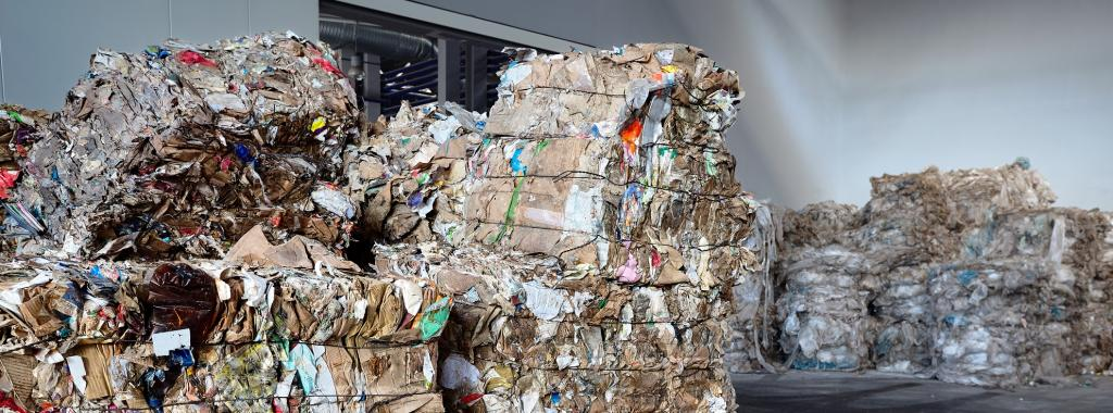 Used cardboard polyethylene and plastic pressed into bales at finished products warehouse. Photo: Getty Images