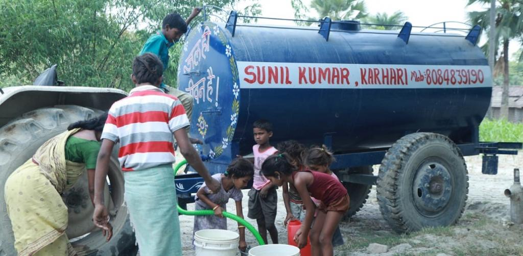 Villagers taking water from government-sponsored water tankers. Photo: DTE
