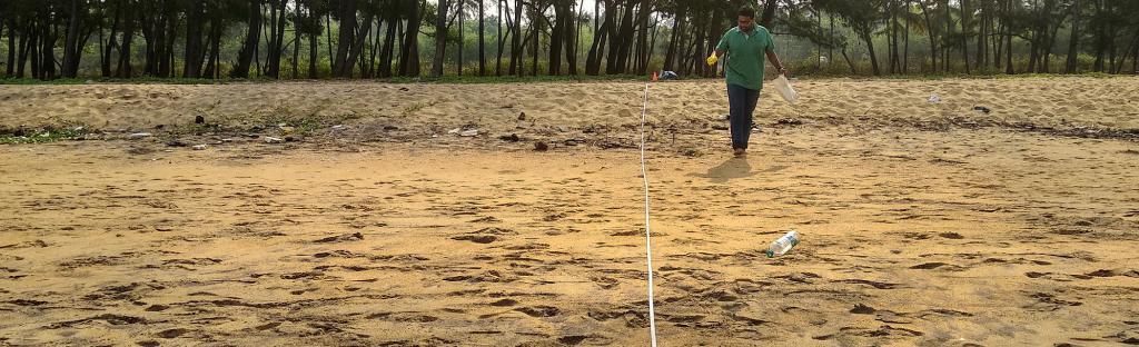 A member of Thanal inspects a Kerala beach. Photo: Sanitta S Mathew