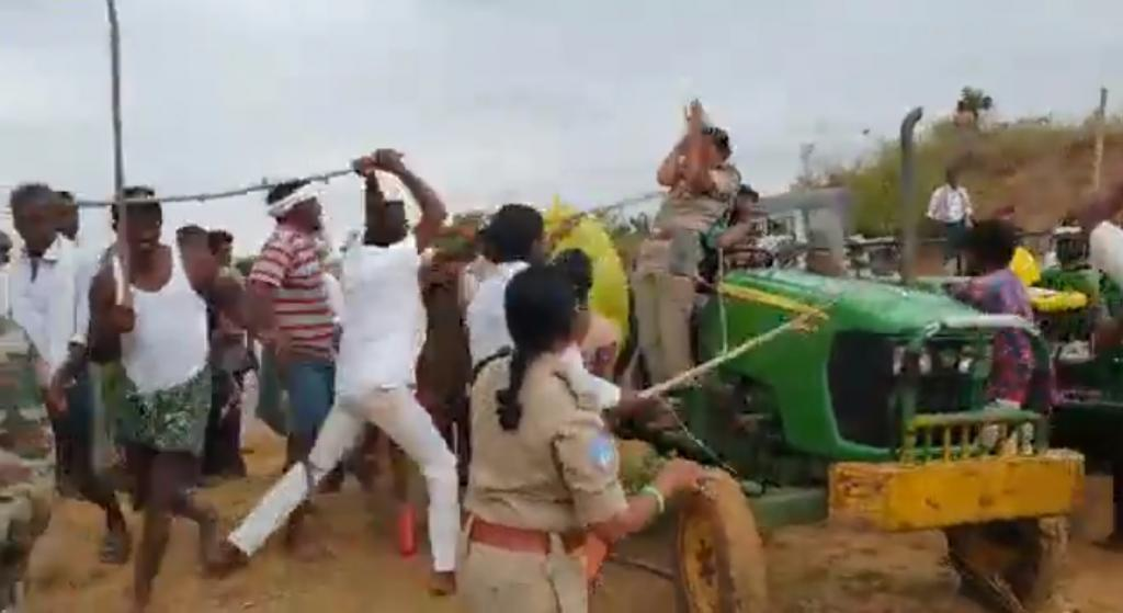 C Anitha being beaten by village residents. Photo: Twitter
