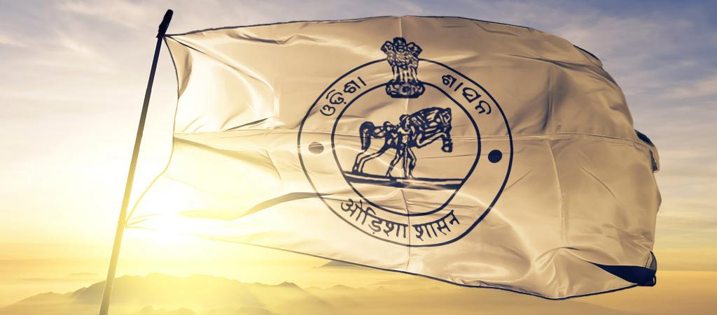 The Odisha state flag waving against the bright sun. Photo: Getty Images