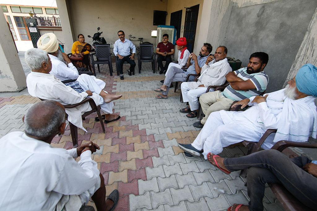 Below: Officials in Kurukshetra's Bir Amin village convince farmers about the viability of switching from paddy  to maize and pulses (Photogrpahs: Reuters, Vikas Choudhary)