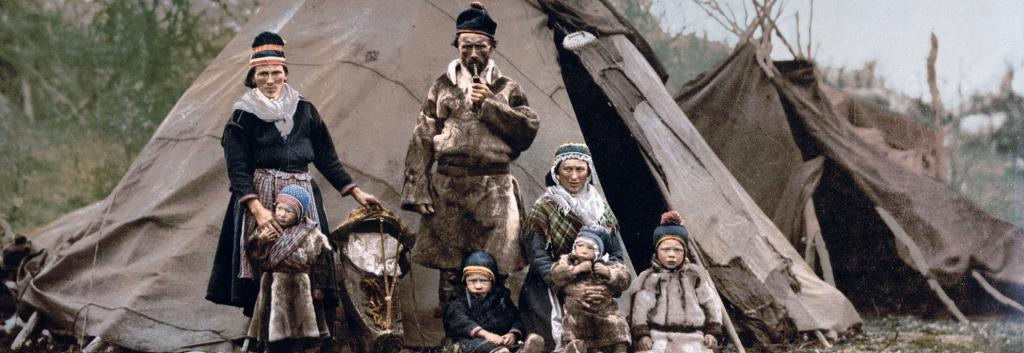 A Sami family in front of their 'laavu' or traditional tent in Lapland. Photo: Wikimedia Commons