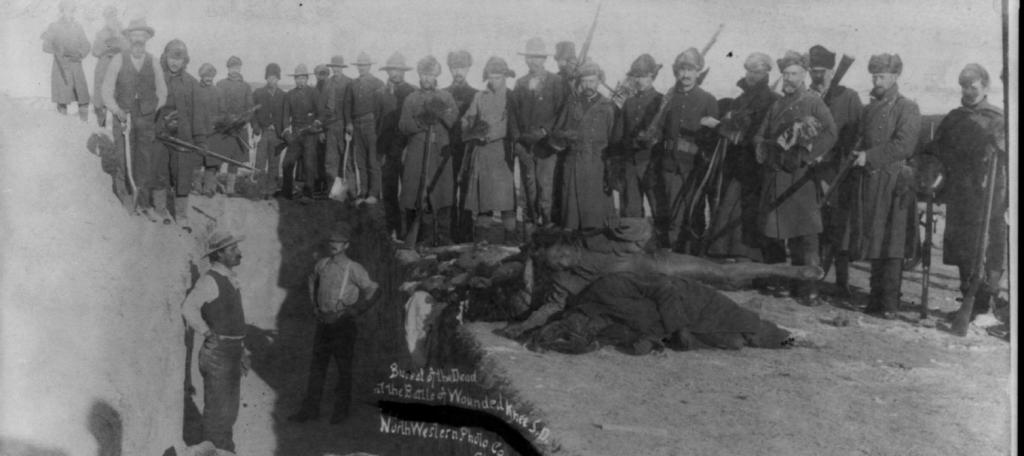 US Army soldiers bury dead Lakota after the massacre at Wounded Knee. Photo: Wikimedia Commons
