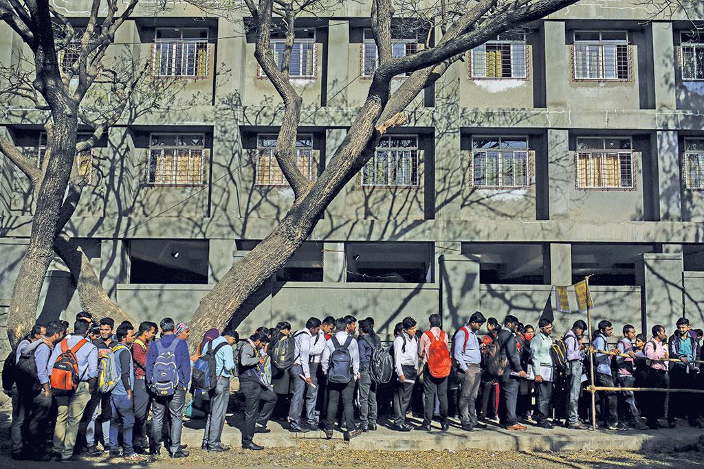 Qualified engineers queue-up at a job fair in Chinchwad, Maharashtra (Photograph: Reuters)