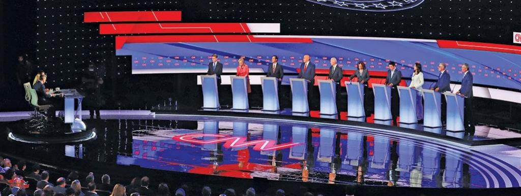 (Left to right) Senator Michael Bennet, Senator Kirsten Gillibrand, Former Housing and Urban Development Secretary Julian Castro, Senator Cory Booker, Former Vice-President Joe Biden, Senator Kamala Harris, Entrepreneur Andrew Yang, US Representative Tuls