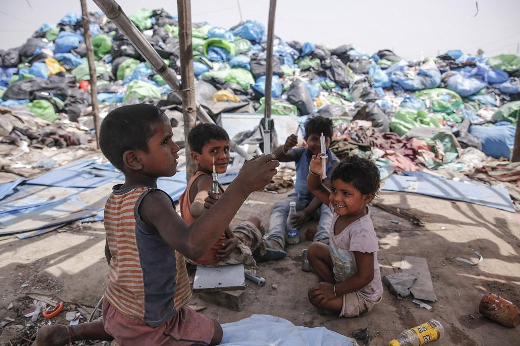 Rohingya children, living with their families in camps in Shaheen Bagh, New Delhi, are often seen playing with broken syringes, used band-aids, blood-smudged gauze and used saline bottles. Most of the Rohingya families work as waste segregators to earn Rs 250/day by sifting through heaps of medical waste. The children often fall prey to diseases, including lung infections and severe skin allergies. Private vendors collect medical waste from prominent hospitals in the city and dump them near such refugee camps. Photo: Vikas Choudhary