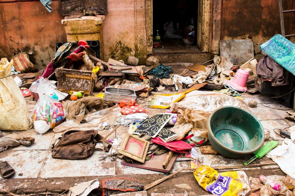 Though the water receded, the flood had left household items such as books, utensils, clothes, etc soaked and villagers had to lay them outside to dry. Normalcy is still distant. Photo: Sanket Jain