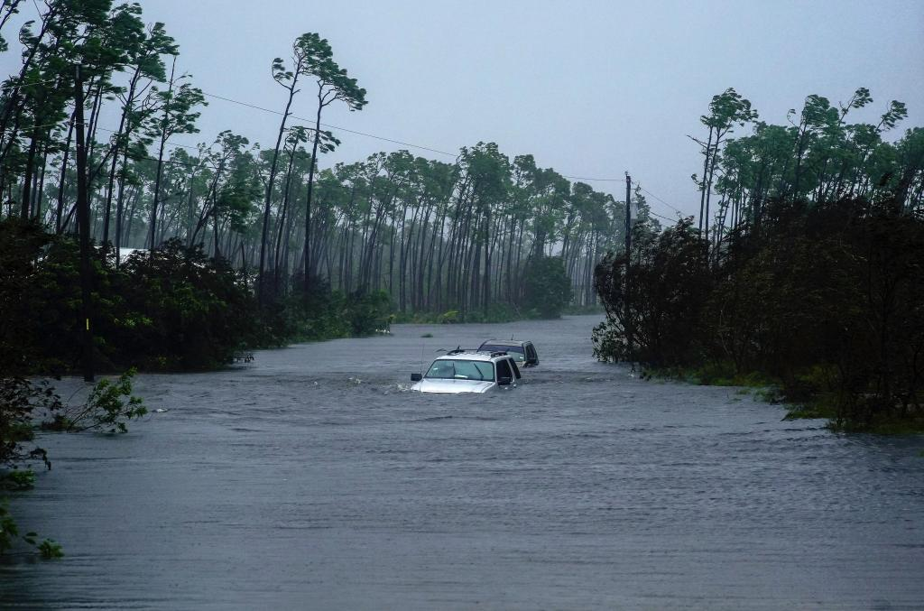 Cars sit submerged in water from Hurricane Dorian in Freeport, Bahamas. Photo: AP Photo/Ramon Espinosa