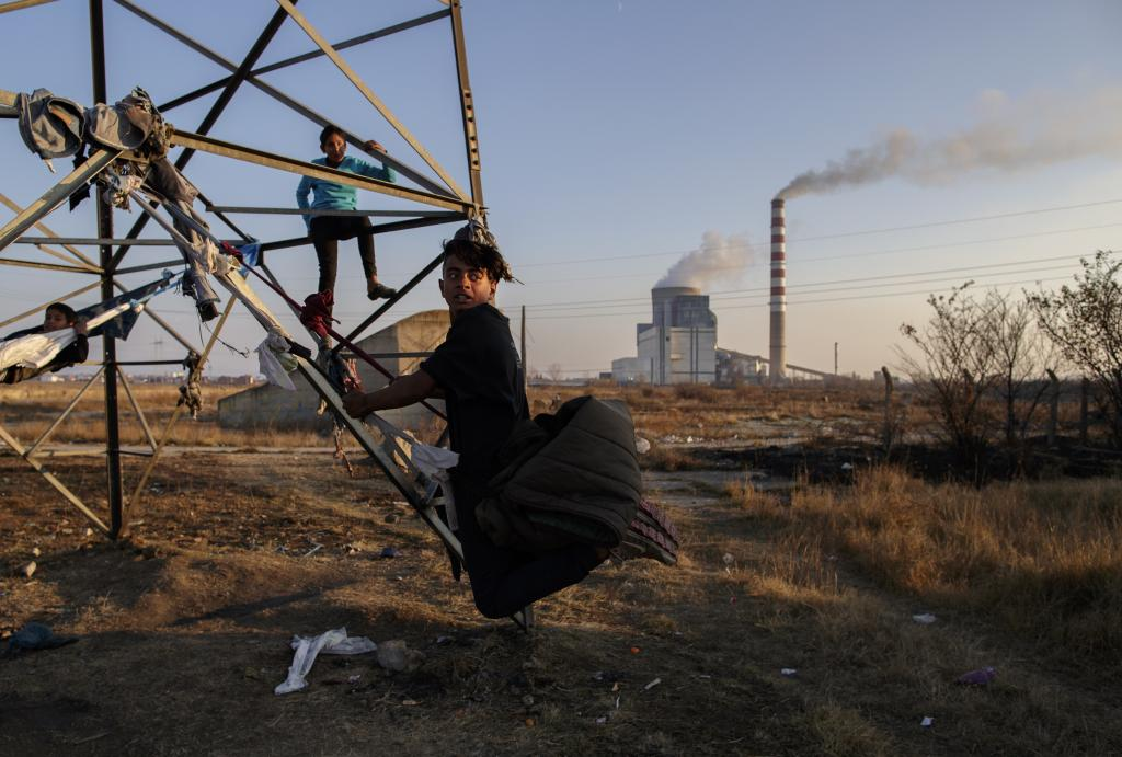Children play near a coal-fired power plant in Obilic, Kosovo. Photo: EPA/Valdrin Xhemaj