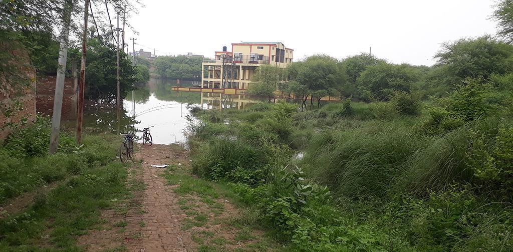 Sewage pumping station near Numayadahi STP submerged in water.