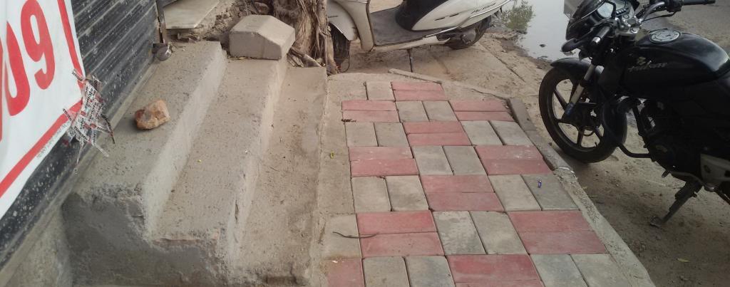 An encroached Delhi sidewalk. Photo: Sugeet Grover
