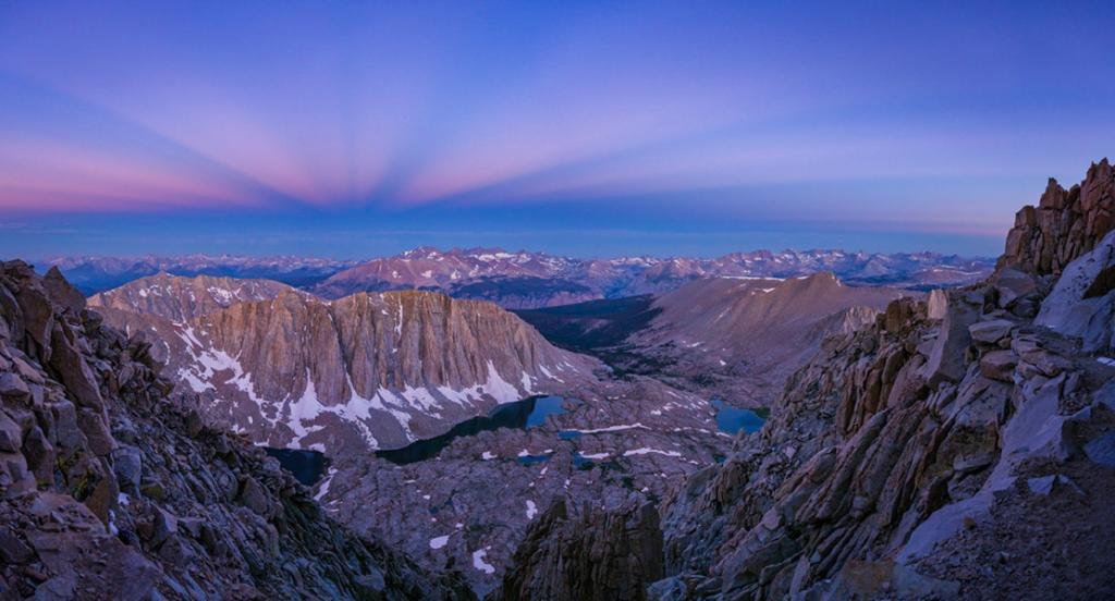 During the twilight hour on August 8, 2019, the blue hour panorama scanned along the clear western sky and looked down at Mt Whitney, from along the John Muir Trail towards the Sierra Nevada mountain range. The Belt of Venus seems to be bordering the falling grey shadow of Earth. Photo: Matthias Ciprian