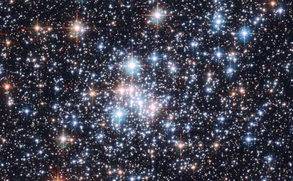 These stars of open cluster NGC 290 were captured in 2006 by the orbiting Hubble Space Telescope. NGC 290 lies about 200,000 light-years away from a neighboring galaxy called the Small Cloud of Magellan. It contains hundreds of stars and spans about 65 light years across. Photo: NASA, ESA, Hubble