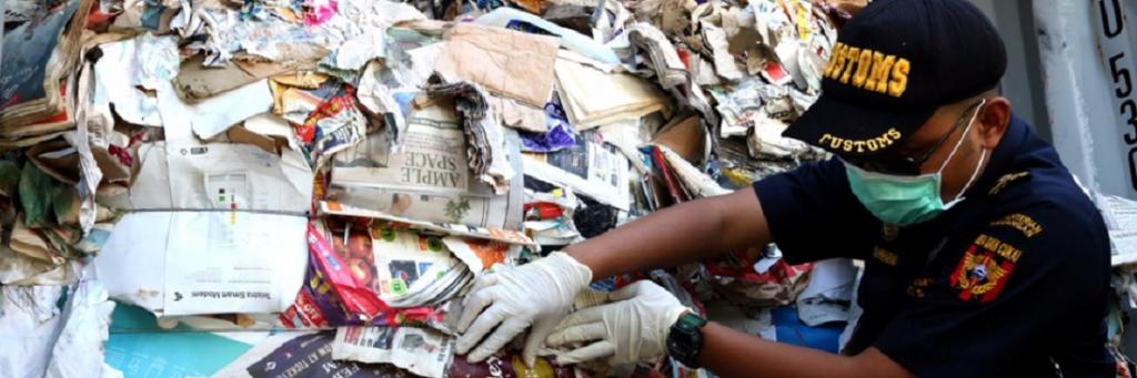 An Indonesian official sifts through hazardous and plastic waste. Photo: Prigi Arisandi, Ecoton