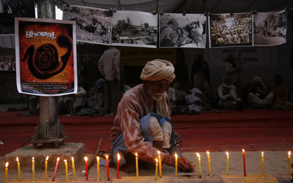 A man lights candles in Delhi during a vigil for the victims of the Bhopal Gas Tragedy. Photo: Vikas Choudhary