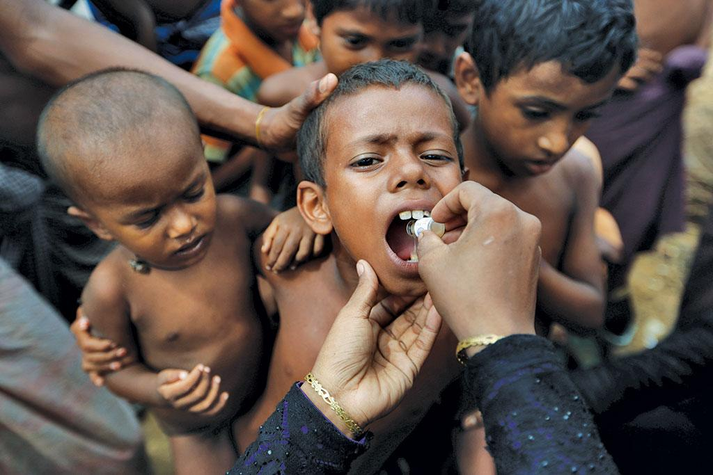 A child in Bangladesh gets an oral cholera vaccine, distributed by the World Health Organization (Photograph: Reuters)