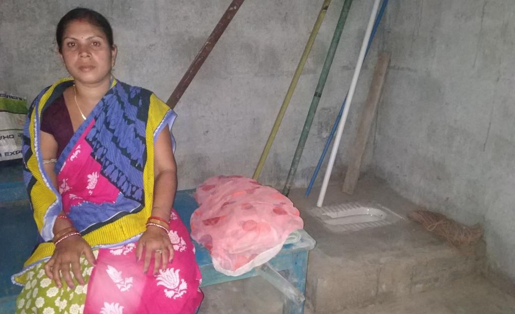 Sandhyarani Lenka in her room in Pandakudia slum, with the toilet bowl located within it. Photo: Pragati Prava