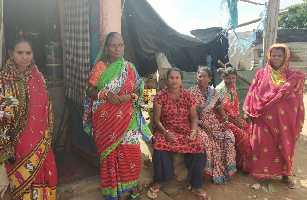 The women of Pandakudia pose outside their shanties. Photo: Pragati Prava
