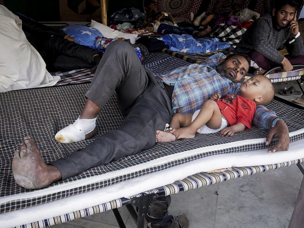 An injured man lies with his kid. According to Anshu Anthony, several people suffered from acid attacks and lathicharge wounds. He added that many new-born kids suffered from jaundice, while women battled depression. Skin allergies due to lack of hygiene were also common.