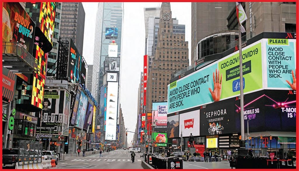 A message about protecting yourself from the coronavirus is seen on an electronic billboard in a nearly empty Times Square in Manhattan in New York