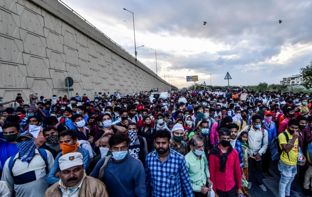 Hordes of people wait in large gatherings at the Anand Vihar Bus Terminal. Following extensive media reportage on the plight of workers, the Uttar Pradesh government arranged 1,000 buses for stranded workers on March 28 to ferry them to their homes.