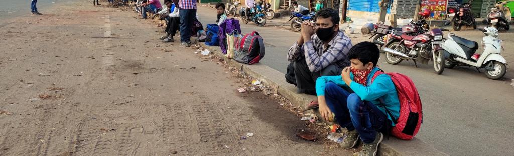 Migrant workers wait near a highway in Odisha to reach their homes Photo: Ashis Senapati