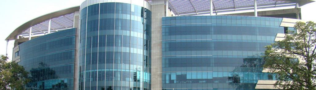 A glass-covered building in Gurugram. Photo: Wikimedia Commons