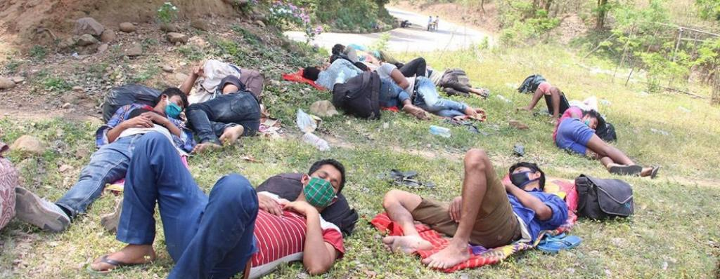 Nepalese migrant workers rest as they travel on foot to interior Nepal due to the COVID-19 lockdown. Photo: Dambar Chemjong