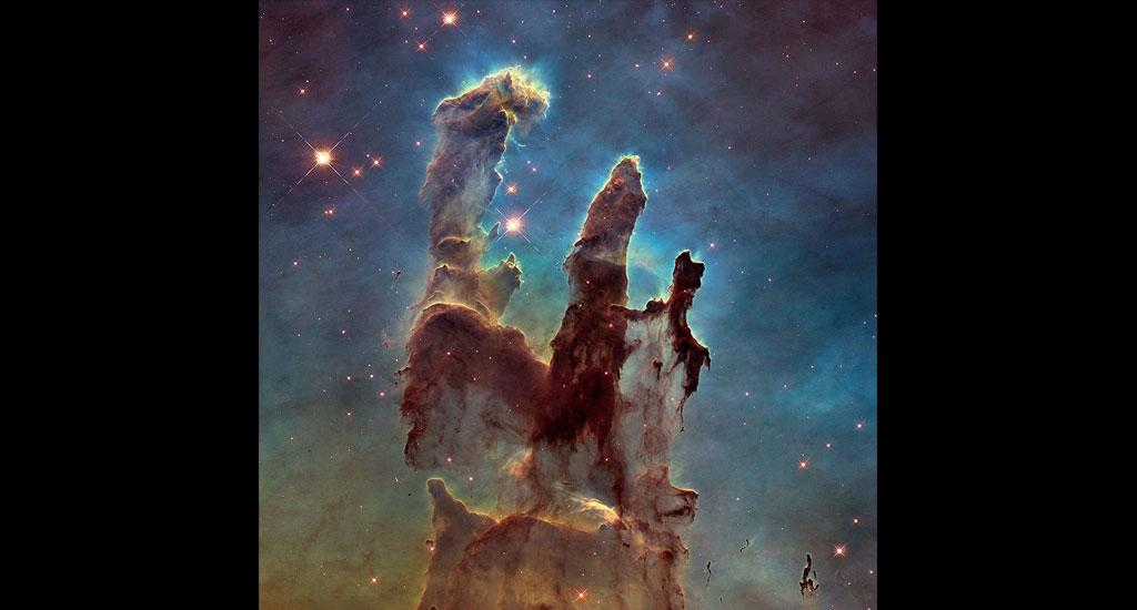The 'Pillars of Creation' — one of the very first images sent by the Hubble telescope in 1995 — show newborn stars hidden in the 'pillars' of the Eagle Nebula, according to the National Aeronautical and Space Administration (NASA). Photo: NASA, ESA and the Hubble Heritage Team