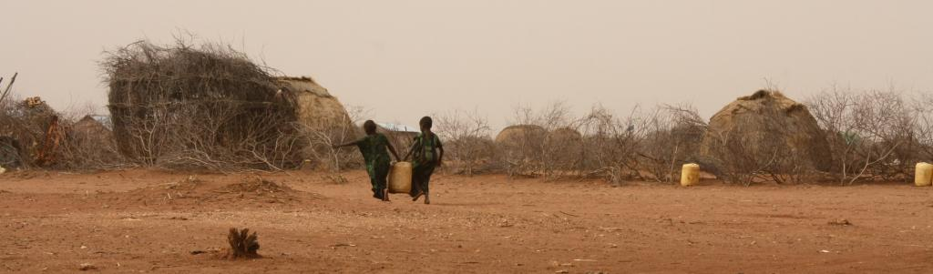 Children carry jerry cans of water in Kenya. Africa stands to be one of the worst-affected by the climate crisis Photo: Wikimedia Commons