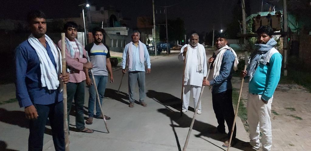Locals take turns to guard entry and exit points in at least 12,800 Punjab villages. Photo: Seema Sharma