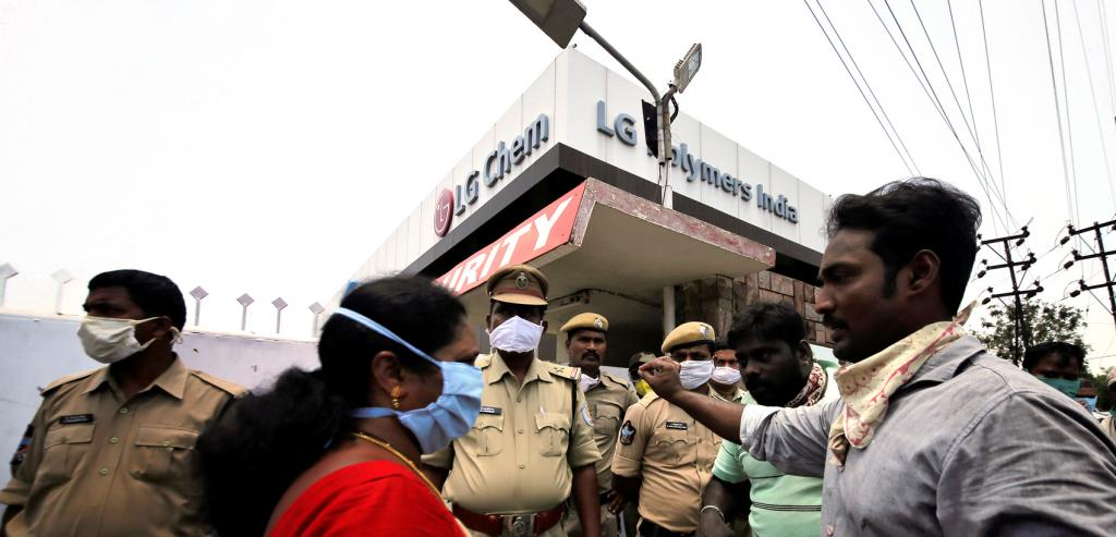 Residents speak with a local politician outside the LG Polymers plant following the gas leak in Visakhapatnam ; Photo: Reuters