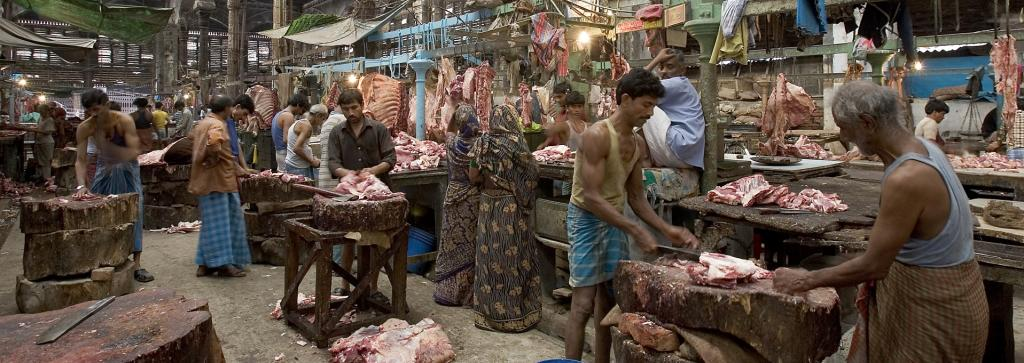 A wet market usually has multiple open-air stalls spread over a large area that sell vegetables, fruits, meat and fresh seafood. Some slaughter and sell live animals on site Photo: Wikimedia Commons