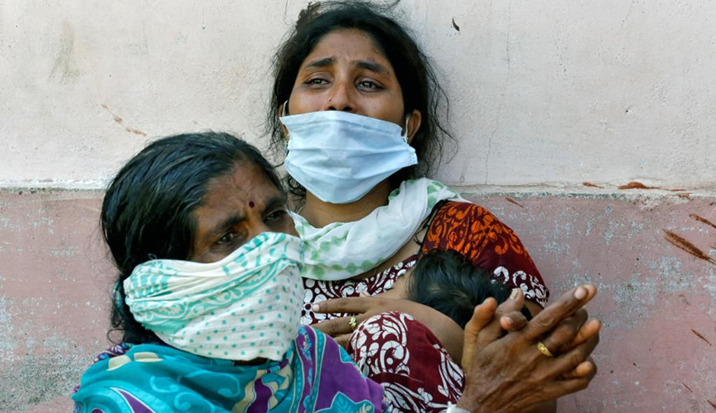Women outside a mortuary to receive the body of a relative who died after the gas leak at the LG Polymers plant in Visakhapatnam on May 8; Photo: Reuters