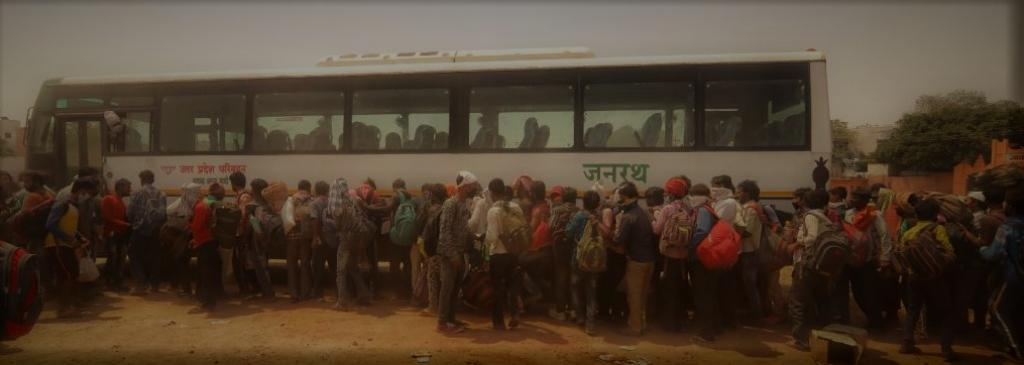 Returning migrant workers queue up for bus. Photo: Vikas Chaudhury