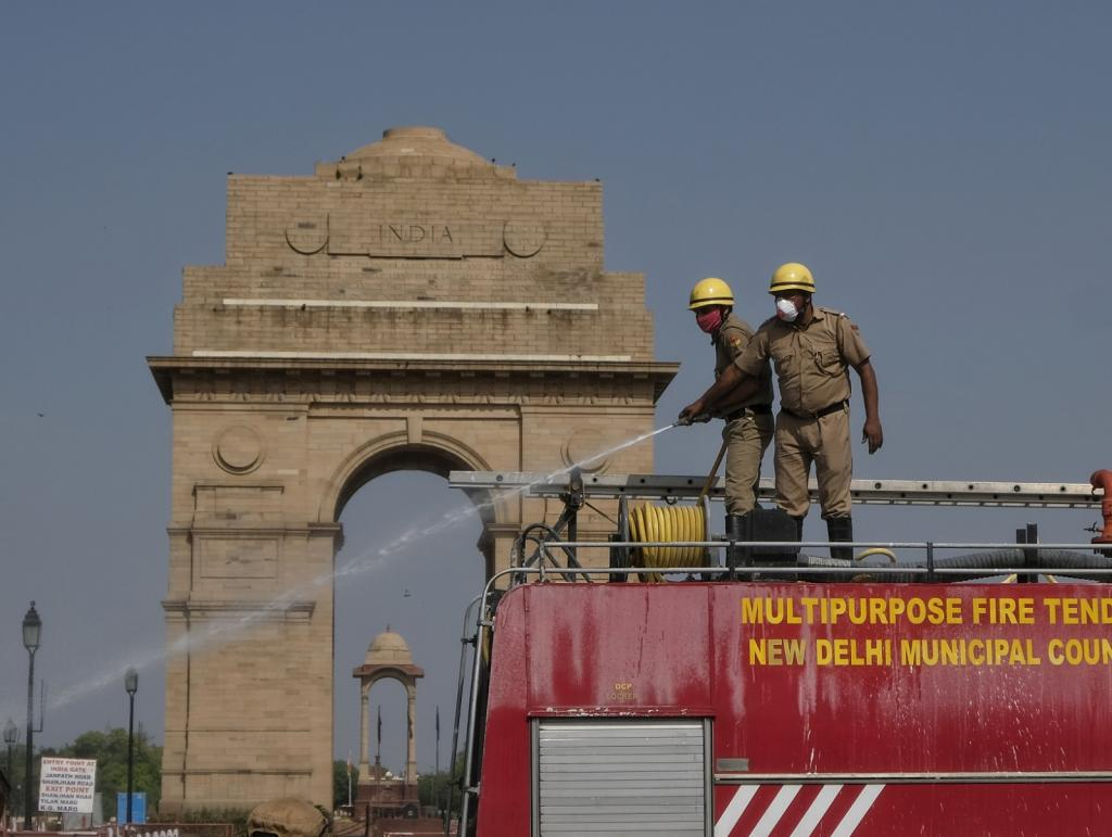 Delhi Fire Service personnel spray disinfectant near India Gate, Delhi during the nationwide lockdown to curb the novel coronavirus disease (COVID-19) Photo: Vikas Choudhary