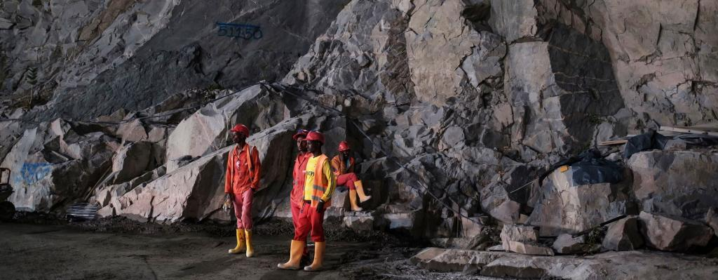 Construction workers stand next to rock wall at the Grand Ethiopian Renaissance Dam in Ethiopia on December 26, 2019. Photo: The Conversation
