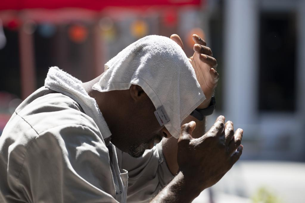 People should be able to recognize dangerous high temperatures to avoid illness or death from heat. AP Photo/Mark Lennihan