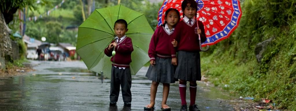 Children in Sikkim on a rainy day. Photo: Wikimedia Commons