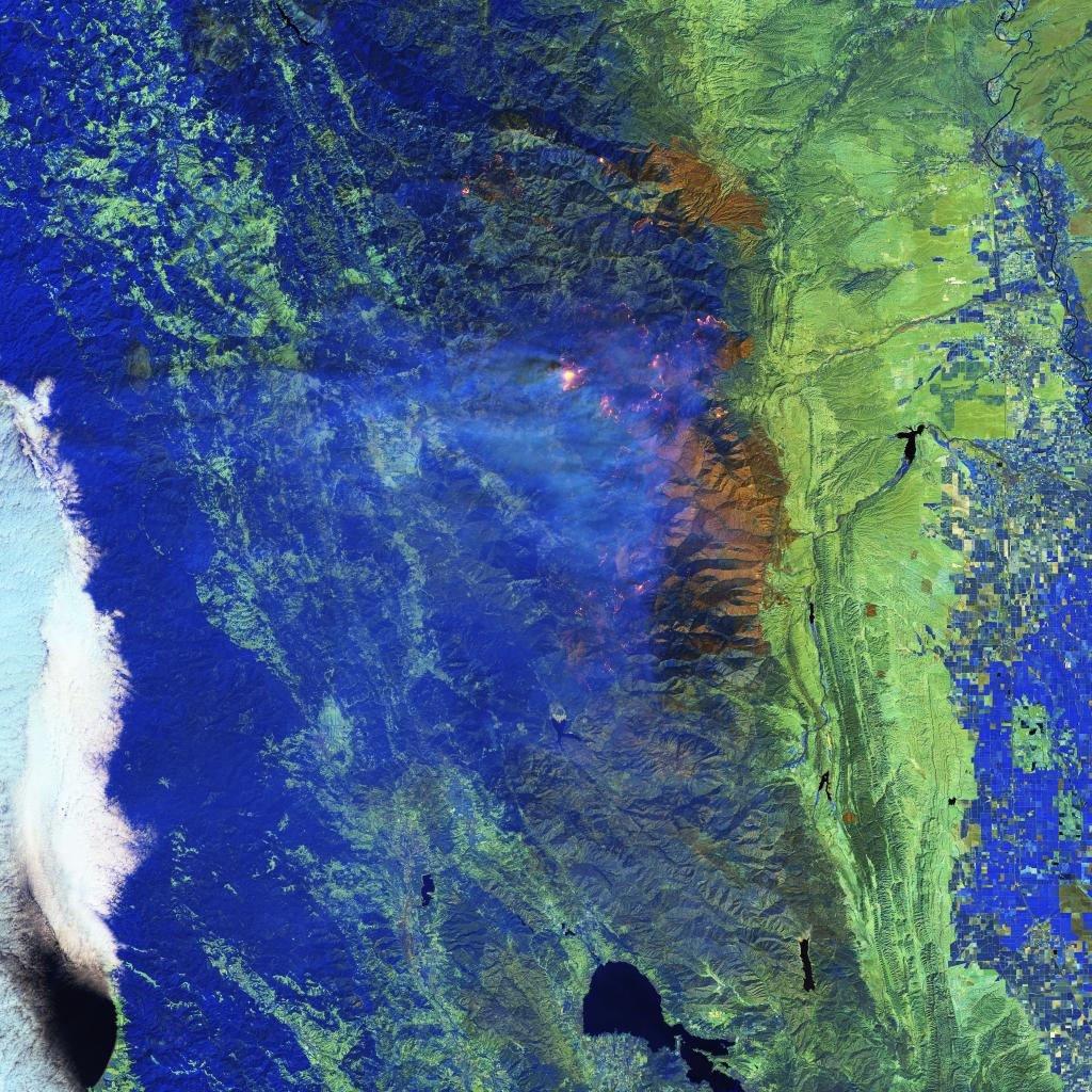 A NASA image shows the intensity of fire through the clouds. The hottest and most active parts of the fire can be seen in yellow, while the pink halo around the main fire area is caused by hot gases emitted in the immediate vicinity of the fire. Photo: NA