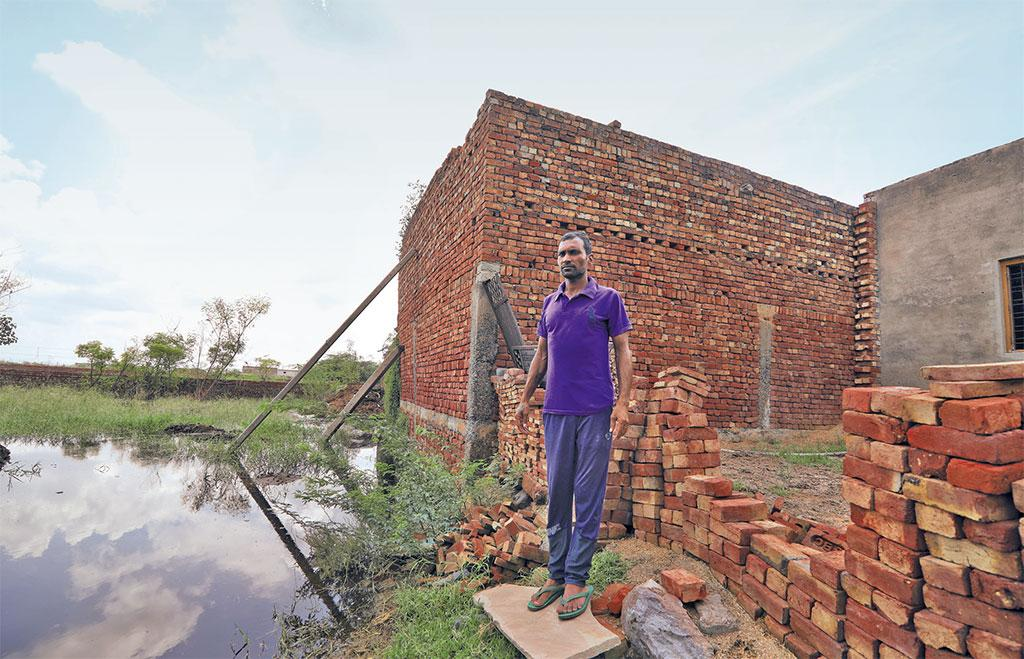 Vikas Kumar has used wooden logs to keep his house from falling. It can collapse anytime, he says