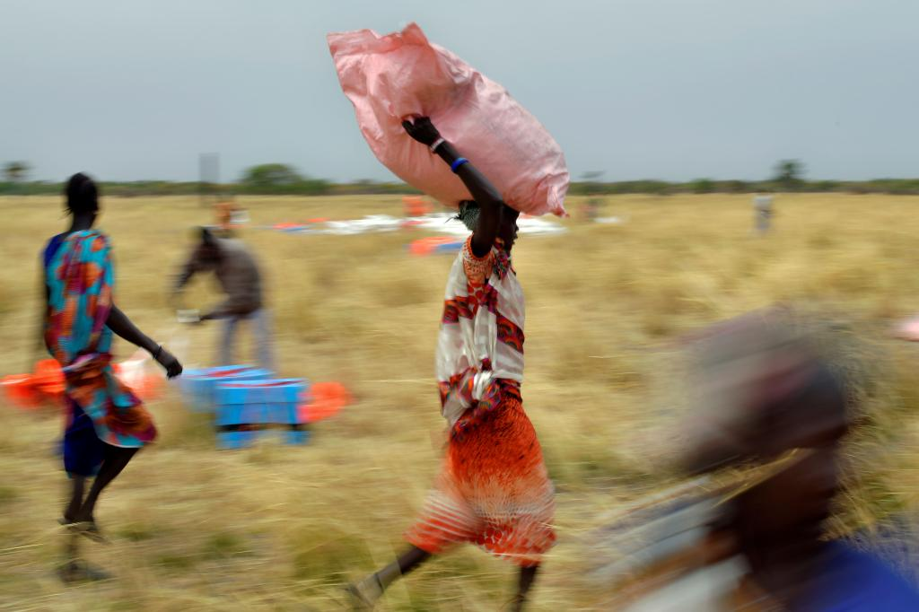 Villagers collect World Food Programme aid dropped from a plane Feb. 6 in South Sudan. Tony Karumba / AFP via Getty Images