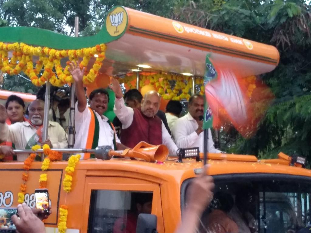 Former BJP president Amit Shah atop a campaign bus in Bengaluru's Cambridge Layout area, campaigning for a party candidate for the 2018 Karnataka Assembly elections. Electoral expenses have been a contentious issue. Photo: Joyjeet Das